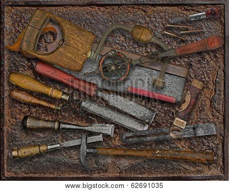 vintage woodworking tools over rusty industrial metal plate