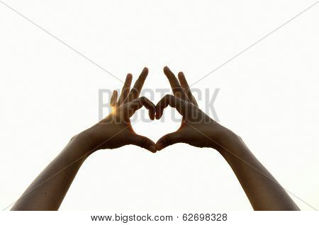 Hands In Heart Shape With Sun In Background