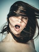 Portrait of a young woman shouting in ecstasy poster