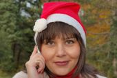 A young Santa Claus is talking on mobile phone looking foward and waiting Christmas's and New holiday poster