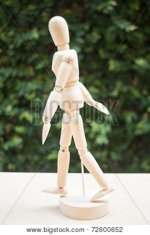 Wood Artist Mannequin Pose Walking On The Table