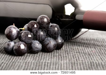 Black Grapes And A Bottle Of Red Wine