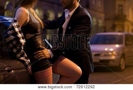 Prostitute Flirting With Businessman