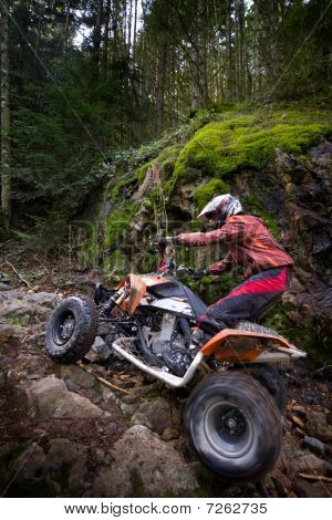 Teen Riding Atv In Mountains