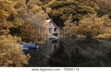 Derelict Old Retro Boathouse And Rowing Boats Hidden In Forest Lake In Autumn Landscape