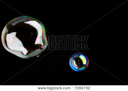 Shiny Soap Bubbles In Front Of A Dark Background