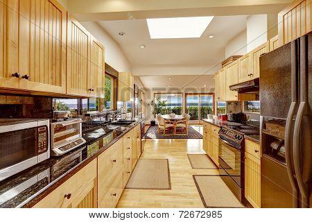 Empressive Kitchen Interior With Shiny Black Granite Tops