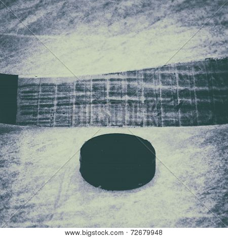 Hockey Stick And Puck. Old Photo.
