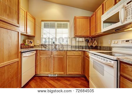 Small Kitchen Area With White Appliances