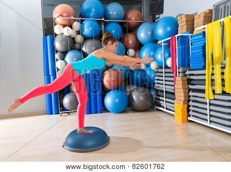 bosu one leg extension deadlift girl exercise at gym workout and swiss ball background poster