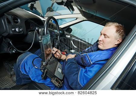 automobile computer diagnosis auto repairman industry mechanic worker servicing car auto in repair or maintenance shop service station poster