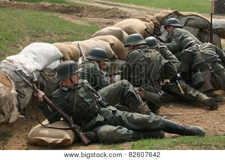 ORECHOV, CZECH REPUBLIC - APRIL 27, 2013: Re-enactors dressed as German Nazi soldiers stage an attack during the re-enactment of the Battle at Orechov (1945) near Brno, Czech Republic.