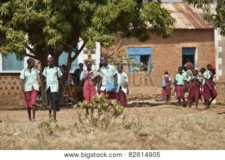 TORIT, SOUTH SUDAN-FEBRUARY 20, 2013: Unidentified schoolchildren are released from school in the village of Torit, South Sudan