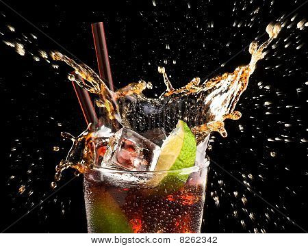 Ice cube and lime splashing cola in glass cuba libre black background closeup poster