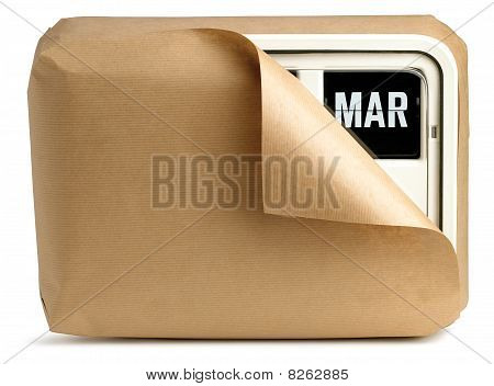 March Office Clock Calendar Wrapped Up In Brown Paper