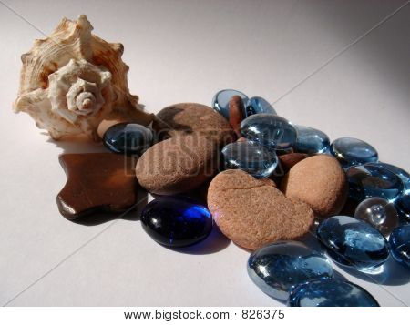 Composition of a cockleshell and polished stones. poster