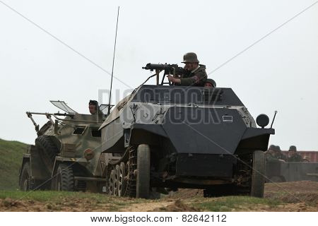 ORECHOV, CZECH REPUBLIC - APRIL 27, 2013: Re-enactors dressed as German Nazi soldiers on a armoured car Leichter Panzerspahwagen attend the re-enactment of the Battle at Orechov (1945) Czech Republic.