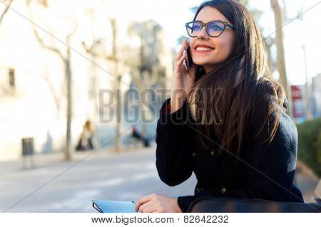 Young Beautiful Woman Using Her Mobile Phone In The Street.
