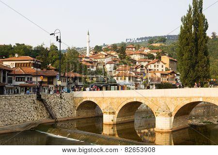 Sarajevo Cityscape With The Miljacka River And A Bridge