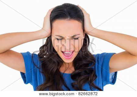 Angry brunette shouting at camera on white background poster