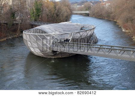 GRAZ, AUSTRIA - JANUARY 10, 2015: An artificial island on the Mur river, called Murinsel - designed from American architect Vito Acconci and built for the European Cultural Capital 2003
