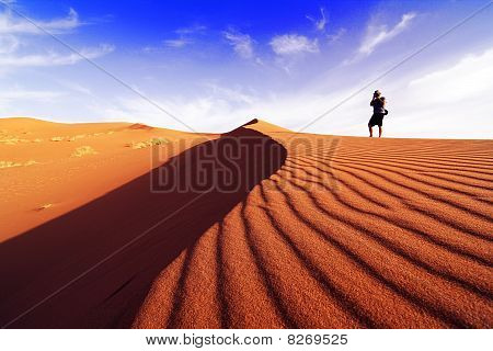 Photographing the desert of southern Morocco on a day of dune poster
