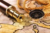 Marine still life with world map and spyglass on wooden table background poster