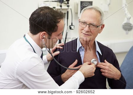 Doctor Examining Senior Male Patient In Hospital