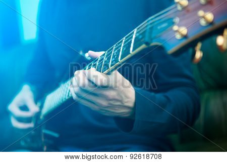 Electric guitar player. Blue lensflare
