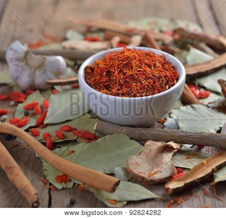 Safflower In The Bowl On Herbs Background