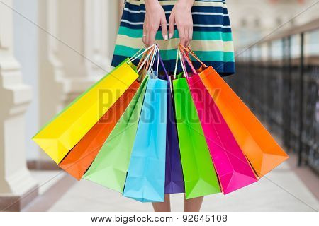 Woman Holding Colourful Shopping Bags At The Mall.
