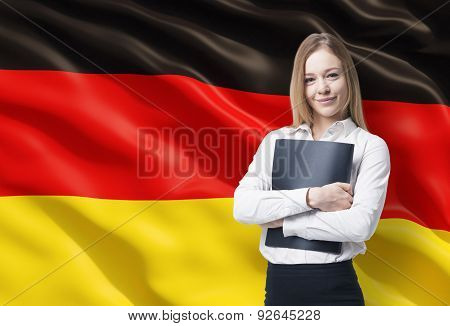 Smiling Business Lady With A Black Folder