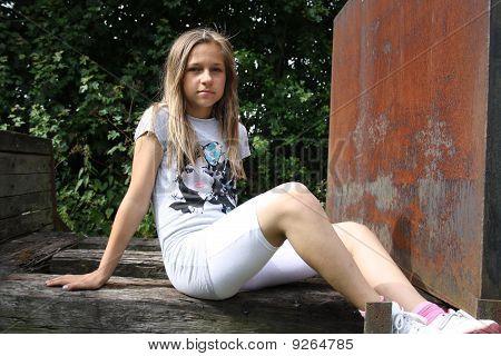 girl sat on farm cart