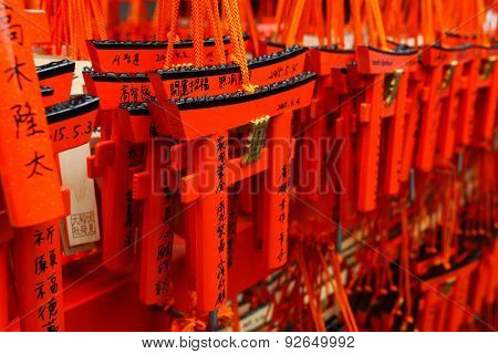 Small Torii gates with written wishes and offerings
