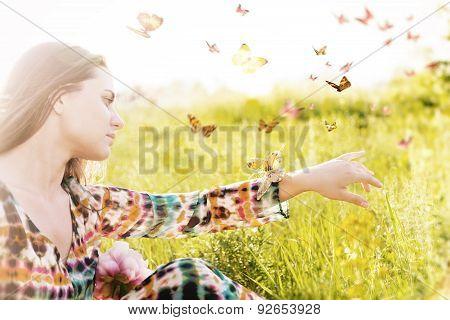 Girl Sitting In A Meadow In A Swarm Of Flitting Butterflies.