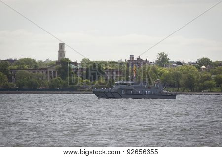 STATEN ISLAND, NY - MAY 20 2015: U.S. Naval Academy Yard Patrol Craft passes by Bay Ridge, Brooklyn along the Hudson River during the Parade of Ships, which begins Fleet Week.