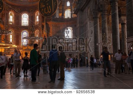 ISTANBUL, TURKEY - MAY 13 2015 : Visitors mingle on the ground floor of the Hagia Sophia Mosque.
