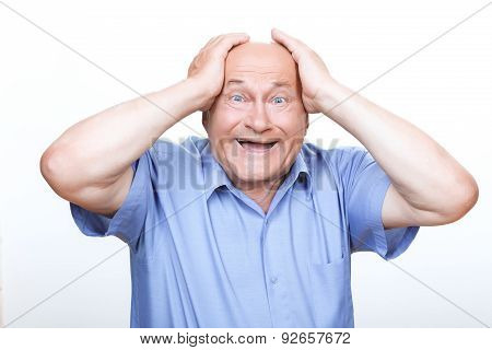 Joyful grandfather touching his head