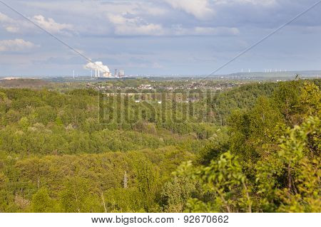 Distant Power Station In Forest Landscape
