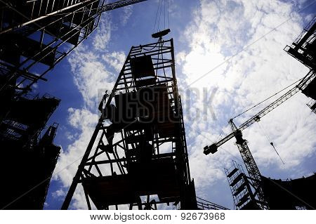 Construction Worker Silhouette On A Scaffold