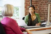 Businesswoman Interviewing Female Job Applicant In Office poster