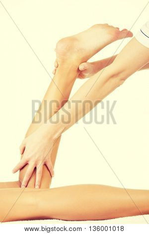 Physio therapist trying to fix the leg