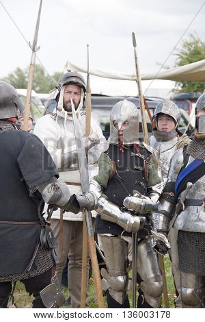 Tewkesbury, UK-July 17, 2015: Knights in armour prepare for battle on 17 July 2015 at Tewkesbury Medieval Festival
