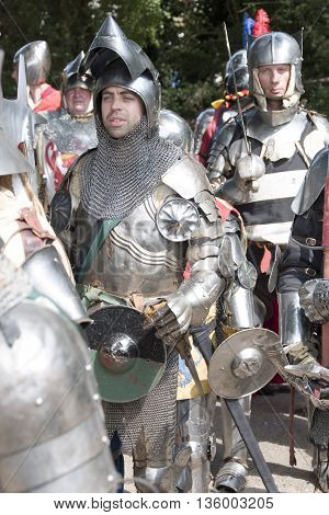 Tewkesbury, UK-July 17, 2015: Knight in armour marching toward battle on 17 July 2015 at Tewkesbury Medieval Festival