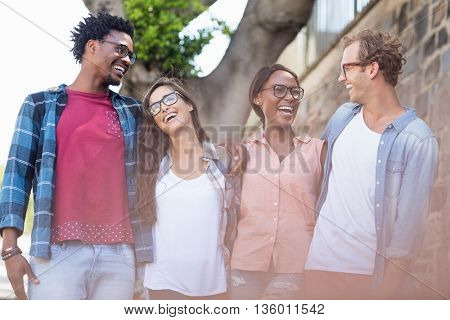 Young couple standing with arm around having fun