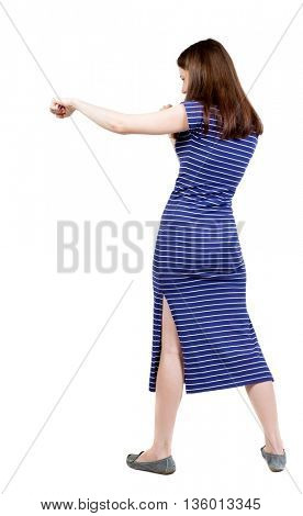 skinny woman funny fights waving his arms and legs. Rear view people collection.  backside view of person.  Isolated over white background. A girl in a long blue dress boxing.