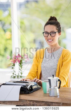 Hipster using type writer in the office