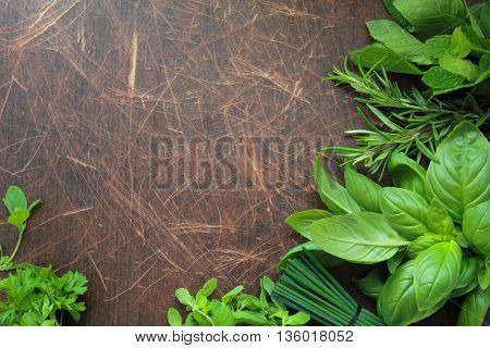 Aromatic herbs on wooden background fresh herbs from garden
