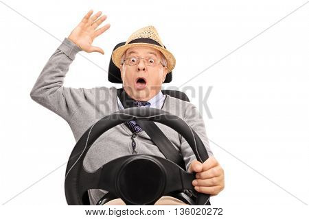 Senior panicking shot in the moment before a car accident isolated on white background