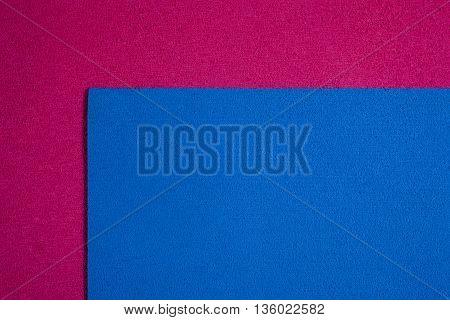 Eva foam ethylene vinyl acetate blue surface on pink sponge plush background